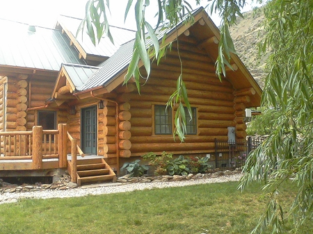 log home stained with lovitts